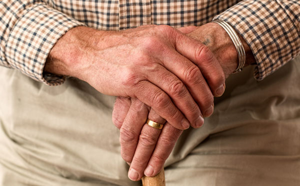 Man hands holding cane